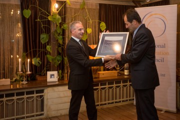 Director of the Energy Community Secretariat (ECS), Janez Kopac (right), on behalf of the ECS, receives RCC's Champion of Regional Cooperation award for 2014 from RCC Secretary General, Goran Svilanović, in Sarajevo, BiH on 25 February 2015 . (Photo: RCC/Amer Kapetanovic)