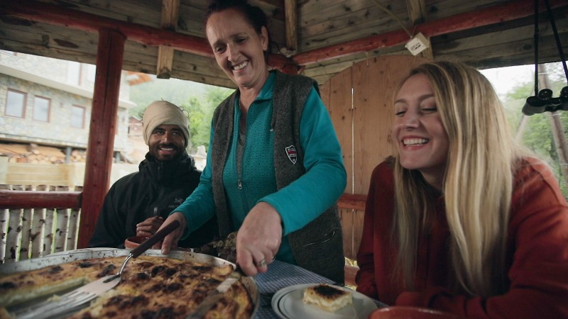 Fetije Nikiqi welcoming  her guests from Germany at her B&B along Via Dinarica hiking trail which runs across the Western Balkans (Photo: RCC/Klicker)