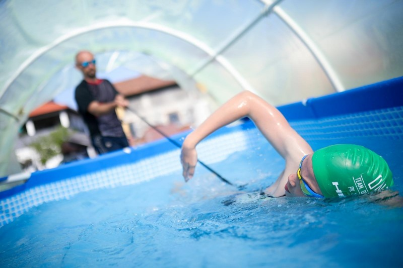 With innovation and know how, the region can incentivize regional economic recovery. Iman Avdic from BiH trains in a pool inside a greenhouse during COVID-19 pandemic when all public pools are closed. (Photo: Armin Durgut/Pixsell)