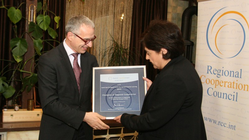 Director of the South East European Centre for Entrepreneurial Learning (SEECEL), Efka Heder, on behalf of her organisation, receives RCC's Champion of Regional Cooperation award for 2013 from RCC Secretary General, Goran Svilanović, in Sarajevo, BiH on 27 February 2014 . (Photo: RCC/Zoran Kanlic)