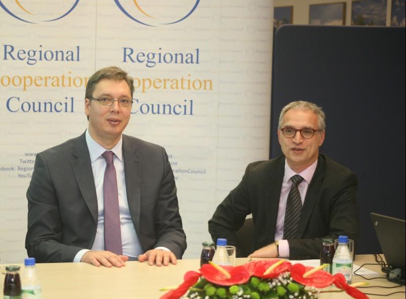 RCC Secretary General Goran Svilanovic (right) welcomes Serbian Prime Minister Aleksandar Vucic at the RCC Secretariat in Sarajevo on 13 May 2014. (Photo RCC/Zoran Kanlic)